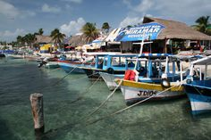 """Gorgeous shot of docked boats on Isla Mujeres, """"Island of Women' off coast of Cancun, Mexico"""