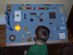 Busy Board made with all kinds of latches and little doors...great for fine motor skills.