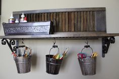 Love our new craft room storage shelf? We reclaimed an old shutter, turning it into a shelf with decorative brackets, then added pails to hold supplies. Craft Room Storage, Storage Shelves, Shelf, Shutter Decor, Decorative Brackets, Old Shutters, Old Windows, Old Doors, New Crafts