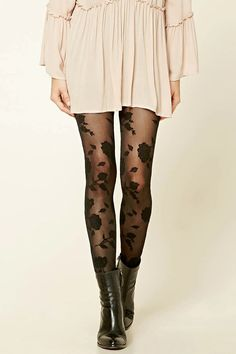 A pair semi-sheer tights featuring an ornate floral print and an elasticized waist.