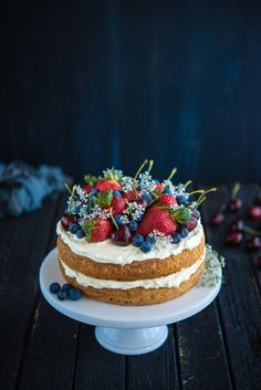 Sponge Cake with Berries and Cherries (The Hungry Australian) | This could be done with a bakery/store bought cake, whip up an easy icing, and finish off with fresh berries/fruit, for a quick dessert. How gorgeous is this presentation!?