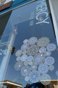Pretty decorations.   Retail storefront installation by April Rose of LightColorSound.blogspot.com at Mercy Vintage on Piedmont Avenue in Oakland.