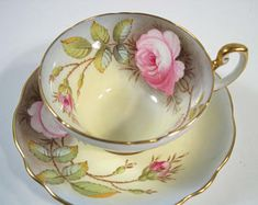 EB Foley Signed A. Taylor Tea Cup and Saucer, From Blue to Yellow with Large Pink Roses teacup and saucer set.