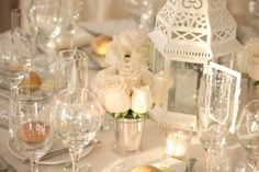 Um yes these are my center pieces  but no white flowers, pink, yellow, purple and blue!  Google Image Result for http://www.exclusiveitalyweddings.com/blog/wp-content/uploads/2012/03/white_lantern-weddingbee.jpg