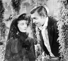 Vivien Leigh as Scarlett O'Hara Hamilton & Clark Gable as Rhett Butler in 'Gone With The Wind'. Rhett speaks to Scarlett at the hospital benefit.