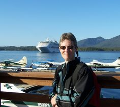 here my sister takes a pic of me with the plane in the back ground.  thought that was nice.  Ketchikan, AK.    June 2006