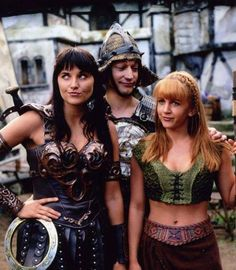 Lucy Lawless as Xena in Xena: Warrior Princess (1995–2001) with Renée O'Connor as Gabrielle and Ted Raimi as Joxer.