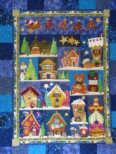 Welcome to the North Pole Quilt 2014. My second version of this lovely pattern by Piece O' Cake, this time mainly with original buildings