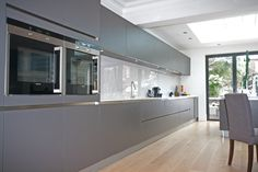 Handleless matt grey kitchen.  Grey is such a versatile colour and a warm grey is an excellent choice for kitchen living.