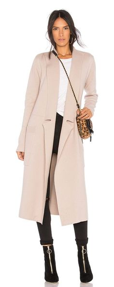 Annabelle Trench Coat by Soia & Kyo. 80% cotton 20% wool. Hand wash cold. Open front. Side patch pockets. Knit fabric. SOIA-WO348. ANNABELLE. Soia & Kyo is known for its fabulous fit, detailing, and extraordinary styling; oversized buttons, asymmetrical collars, wide belts,... #soiakyo #coats #outerwear