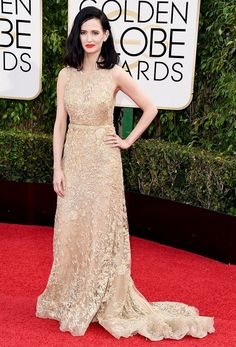 Eva Green wears a nude Elie Saab Haute Couture sleeveless, high neck embroidered tulle and lace gown.