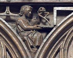 Poitiers choir stalls, spandrel 20 - an architect with his tools