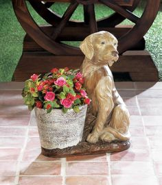 This smart dog is wearing a vest and standing guard next to a stone-looking flower pot! This fun planter will look great in your home or on your patio. Fill the empty planter with your favorite flowering plant to make it irresistable!