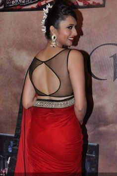 Divyanka Tripathi- The flawless beauty Divyanka Tripathi is looking gorgeous in a see-through backless blouse she sported during an event. Divyanka who is currently seen in Star Plus' Yeh Hai Mohabattein plays an entirely contrast character than what she looked in the picture. Divyanka stepped into the glamour world through Zee Cine Star Ki Khoj on Zee TV and immediately bagged the lead in Banoo Main Teri Dulhan.