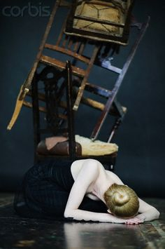 Woman laying by chairs    By: Elisa Lazo de Valdez