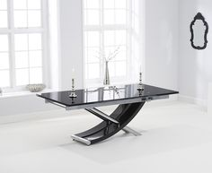 Bonsoni is proud to present this Hackford Glass Extending Dining Table. This is a beautiful, strong, and sturdy Dining Table. This Hackford Glass Extending Dining Table has finish and N/A. The Hackford Extending Black Glass Dining Table Black Glass Dining Table, Wooden Dining Tables, Extendable Dining Table, Dinning Table, Glass Table, Dining Room, Dining Furniture Sets, Glass Furniture, Mark Harris