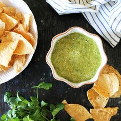 A simple homemade Roasted Salsa Verde recipe flavored with tomatillos, jalapenos, garlic, scallions, cilantro and lime juice. A perfect Game Day appetizer.