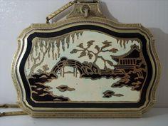 Art deco enamel vanity powder compact,oriental scene.