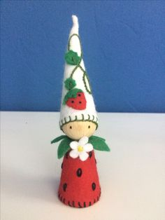 Strawberry peg doll. I made it after seeing a photo. I'm not sure who has made the original design. If it's yours, let me know and I'll put your name up here. Waldorf nature table.