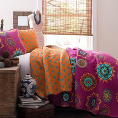 3-piece cotton quilt set with a multicolor suzani medallion motif.  Product: 1 Full/Queen quilt and 2 shamsConstruct...