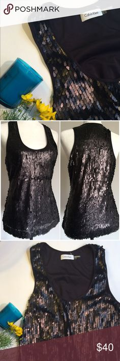 CALVIN KLEIN sequined top size S, EUC Perfect for a night out, it's a bit different than other sequin tops because it reflects quality. Shoulder to hem is 25 inches, flat across is 17 inches under armpit, 16 inches waist. Size small, probably worn once or twice. Looking for a new home! And some parties  Calvin Klein Tops Tank Tops