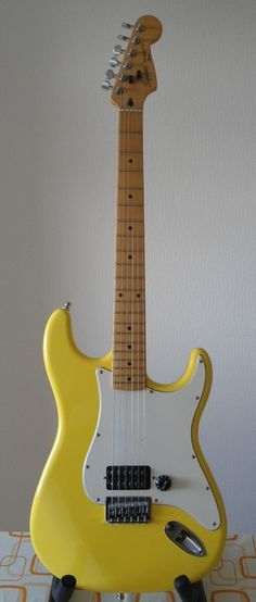 Fender Stratocaster. Miss the extra string guards but LOVE THE YELLOW