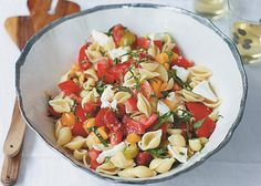 Conchiglie alla Caprese (con-kee-li-eh ah-la ka-prey-seh) is an Italian name meaning pasta shells with tomato, basil and mozzarella. This recipe comes to us from Corky, Lori, Dana and Tracy Pollan, authors of The Pollan Family Table. Serves 6 Cooking Tip of the Week: Heirloom tomatoes are in season in late July in most parts of the […]