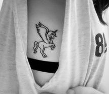 Pegasus tattoo on side