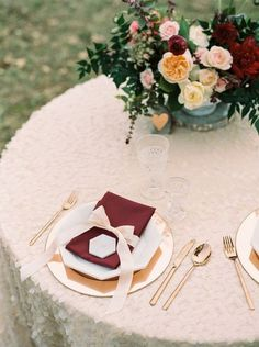 glam table setting with burgundy and blush details