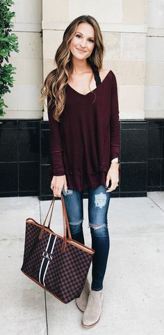 12052d147079a  winter  outfits maroon v-neck long-sleeved shirt with distressed blue denim