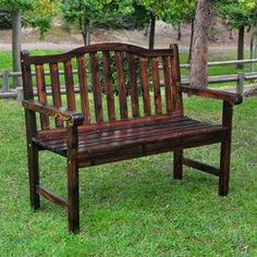 """Cedar wood garden bench with a slat-back and burnt brown finish.     Product: BenchConstruction Material: Cedar woodColor: Burnt brownFeatures:  Use of polyurethane paint for protection against weather, heat and sunlightRust resistant hardware Dimensions: 36"""" H x 44.75"""" W Note: Some assembly required"""