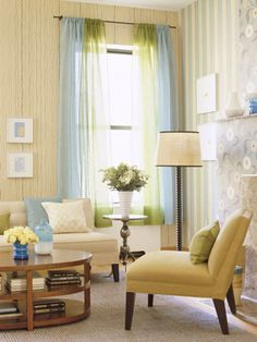 This nearly neutral room stays warm year-round with touches of sunny yellow, watery blue, and grass green. The sedate background is a smart long-term choice since the room can be updated in a snap with just a change in accessories.