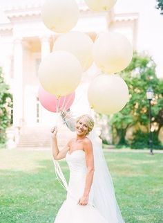 The only thing more joyous than this smiling bride are these happy balloons.
