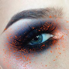 Shadows used are @makeupgeekcosmetics Stealth, @nyxcosmetics Primal Color in Hot Black, @thekatvond @katvondbeauty Metal Crush in Thunderstruck Orange splatter is the Orange shade from the @kryolanofficial UV Dayglow Aquacolor palette Lashes are @powderandpandemonium Hypatia Brows are @nyxcosmetics Tame n' Frame in Blonde and Brunette