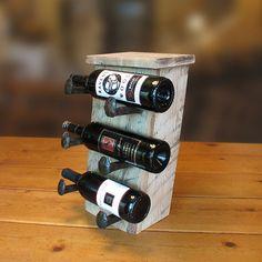 Rustic wine rack, counter wine bottle holder with railroad spike hooks. $75.00, via Etsy.