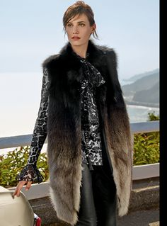 St. John - Caviar/grey ombre fox fur vest with pockets fur origin: China $. Caviar multi blouse with detachable scarf $. Caviar Nappa leather legging $. Caviar/dark gunmetal chain and leather belt $.