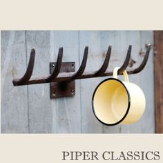 """Rack Rake Wall Hanger, 15"""" wide x 4 1/2"""" deep. A versatile hanger for jackets, caps, or hand towels. Great county accent in kitchen or hallway."""