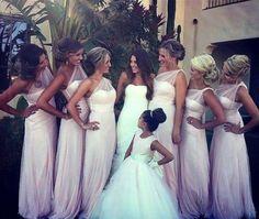 Elegant soft pink one shoulder bridesmaid dresses.