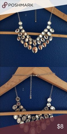 Statement necklace clear crystals costume jewelry Beautiful never worn statement necklace. Clear crystals with mirror background. 3 layers big beautiful piece. Purchased at H&M in Amsterdam. Silver color chain and clasp H&M Jewelry Necklaces