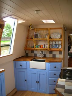 Storage tips for boats - crockery storage in a boat kitchen Narrowboat Kitchen, Narrowboat Interiors, Wood Interiors, House Boat Interiors, Barge Interior, Interior Ideas, Interior Inspiration, Rv Interior, Canal Boat Interior