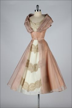 1950's Dusty peach organza and with lace insets.  Cocktail dress with portrait collar.  Acetate lining.