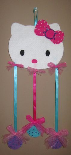 Assuming she will grow hair long enough... Hello Kitty Hairbow Holder Pink Purple Blue. $8.00, via Etsy.