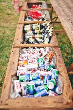 Use a flower box as a rustic drink cooler. Good idea for a outdoor wedding.
