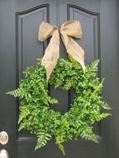 boxwood/ferns wreaths - love love love love loveeeeeeeee for the wedding! w/ a black and white striped bow!