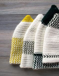 No pattern info, but I assume two strands of wool held together, with color gradations, cone shaping at top, working down to head circumference, working in a spiral.