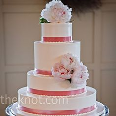 The cake was frosted with ivory buttercream and accented with pink ribbon and fresh pink peonies.