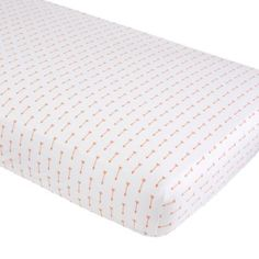 Our examplary Iconic Crib Sheet will match nearly any decor.  It features a slew of orange arrows on a white background and is made from comfy, 100% cotton. Details, details Nod exclusive 200-thread count cotton percale Crib Fitted Sheet available in orange arrow print or solid orange Crib Sheet is fully elasticized for a snug, secure fit Imported For complimentary swatches, please email customerservice@landofnod.