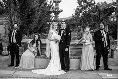 Black and white photo of the bride and groom in front of one of our beautiful fountains during their real vineyard wedding at Mount Palomar Winery in Temecula, California. Fall is the perfect time for a wedding in wine country! #mountpalomarwinery