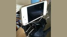 Make an iPhone holder for a tripod with two large binder clips. Brilliant.
