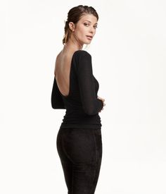 Fitted top in jersey with a low-cut back and long sleeves.